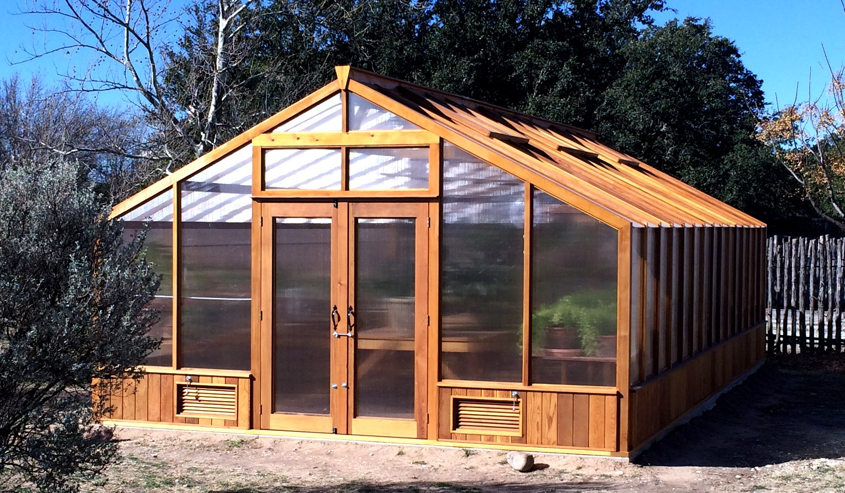 Greenhouse kits by cedar built for Small wooden greenhouse plans